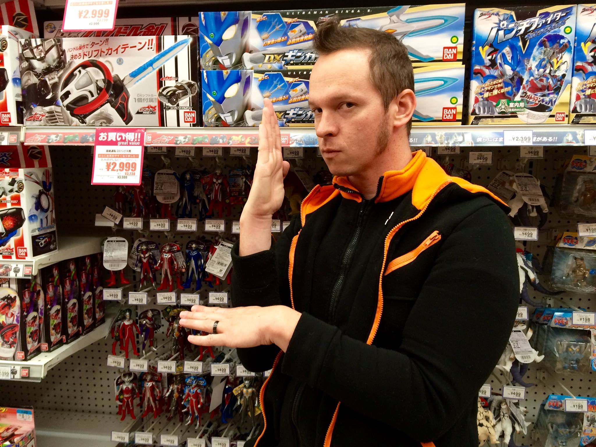 Gaz is in Japan standing in front of a display of Ultraman Toys